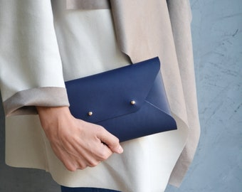 Navy blue leather clutch bag