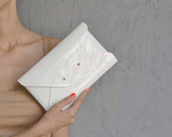 Off white leather clutch bag