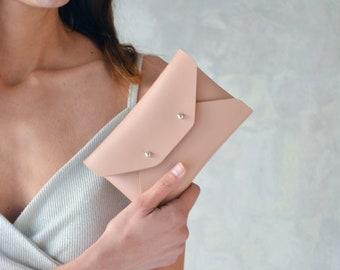 Nude leather mini clutch