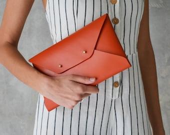 Burnt orange leather clutch bag