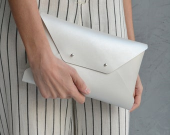 Pearl colored leather clutch bag