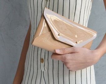 Patent nude-beige leather clutch bag