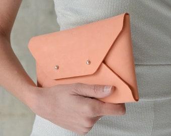 Peach leather clutch bag