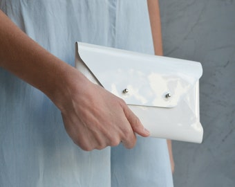 Patent white leather clutch bag