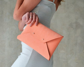Peach leather clutch bag