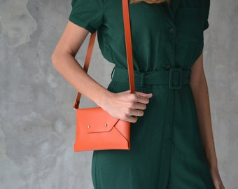 Burnt orange leather clutch bag