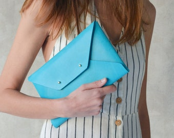 Deep aqua blue leather clutch bag, available with strap