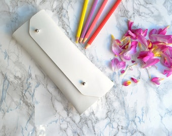 White leather pencil case