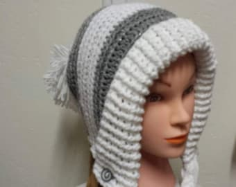 Slouchy, earflap hat with braids and pom pom.
