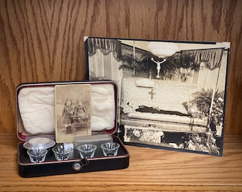 Freak your friends out! Dead guy photo, creepy kids cabinet card, antique communion set in case. Strange assemblage of weird things.
