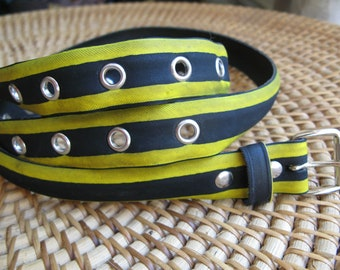 Yellow belt made from a recycled bike tire, with eyelets - 2,6cm wide