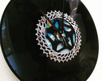Wall clock made with an old bike cassette and a vinyl record