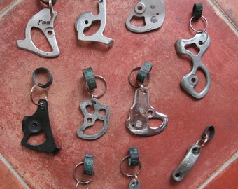 Keychains made from a recycled bike Simplex derailleur
