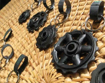 Keychains made from recycled jockey wheels