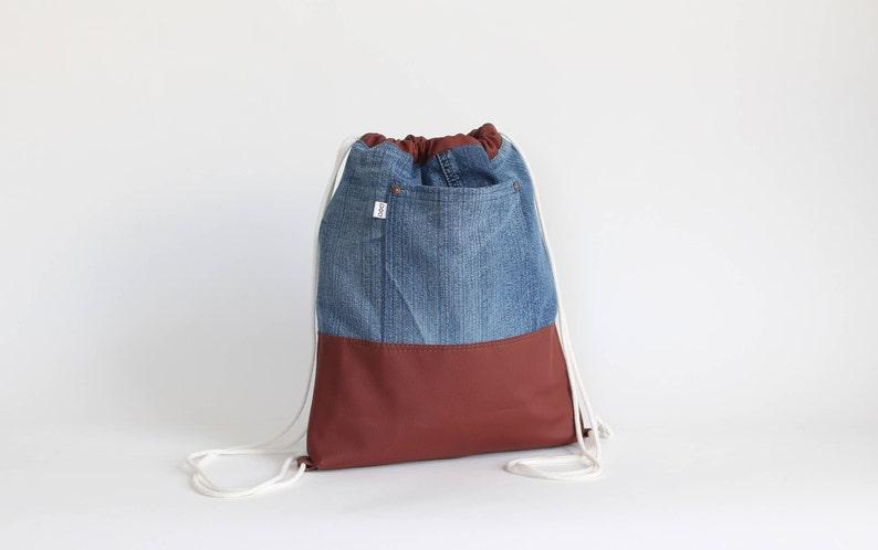 f896ec846 Mochila Denim con bolsas de cuero sintético | Etsy