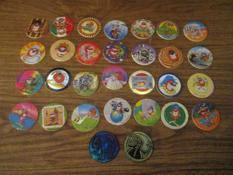 Whammers / Pogs / Tazos / Milk Caps / Collection of 30 Pog World Tour  Edition Milk Caps / Slammer (1994)