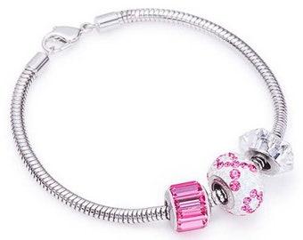 Pink Ribbon Pavé Charm Bracelet made with Swarovski® Charms