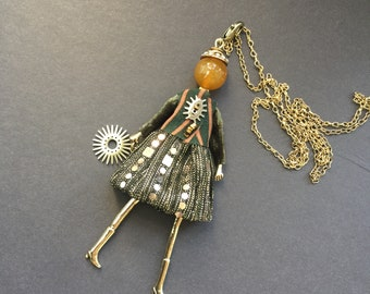 Necklace Gold Tone Dawn Doll with Red Stones