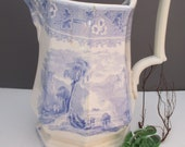 C1850 Romantic Staffordshire Pitcher 9inch light blue transferware, castle, trees, water, ruins scene