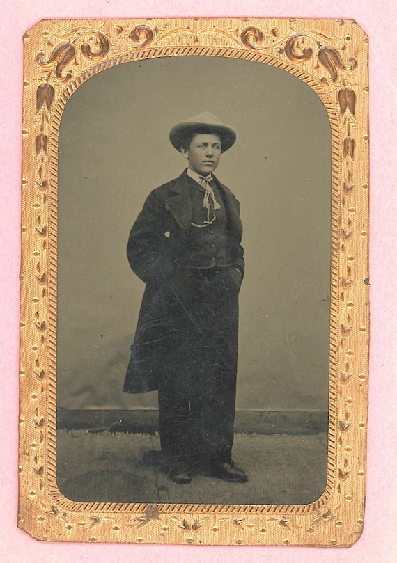 Antique tintype full figural young man in suit & hat tinted cheeks watch fob, suit, embossed brass matting, quite dapper! formal cowboy look