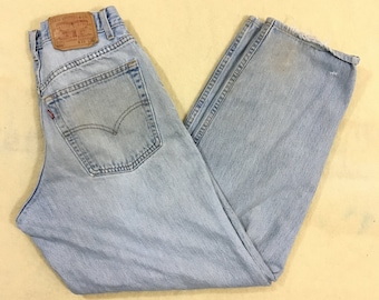 56b60d02bdb Vintage Levi s 570 Baggy Fit Tapered Leg Light Wash Distressed Jeans -  33x32 - Made in USA