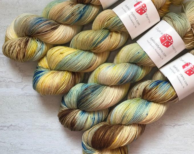 Featured listing image: By the Sea - Beige, Yellow, Brown, Blue - Hand Dyed Yarn - Squish Wish Sock - 75% Superwash Merino Wool/25 Nylon