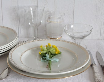 6 white and gold plates made by hand, 30s.