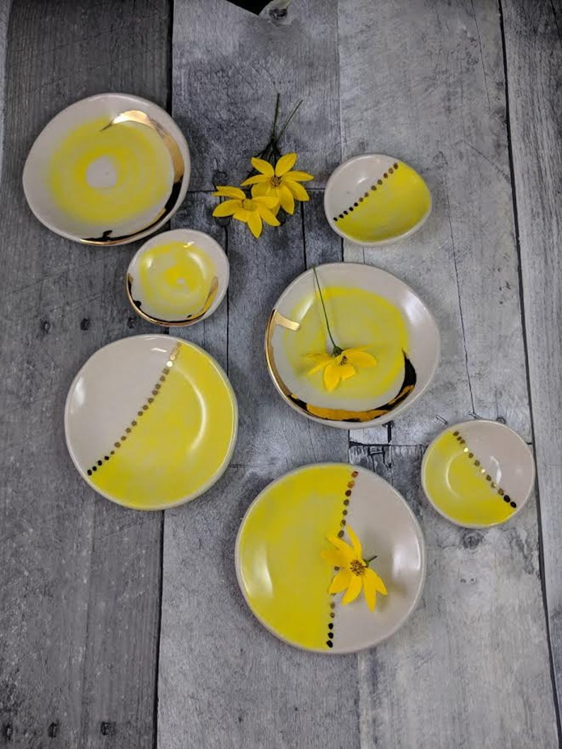 small jewelry dish with bright yellow design and 22k gold embellishments