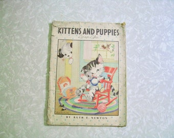 Kittens And Puppies. Linen-like book by Ruth E Newton. Written on, incomplete, torn loose pages.