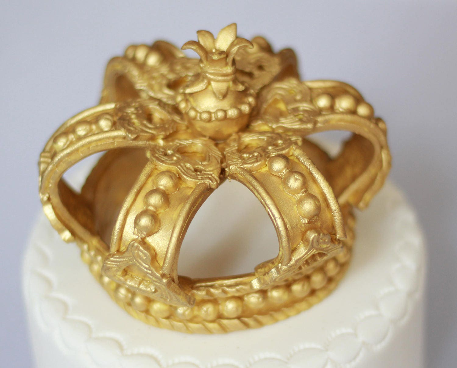 Fondant gold crown cake topper. King crown or queen crown for