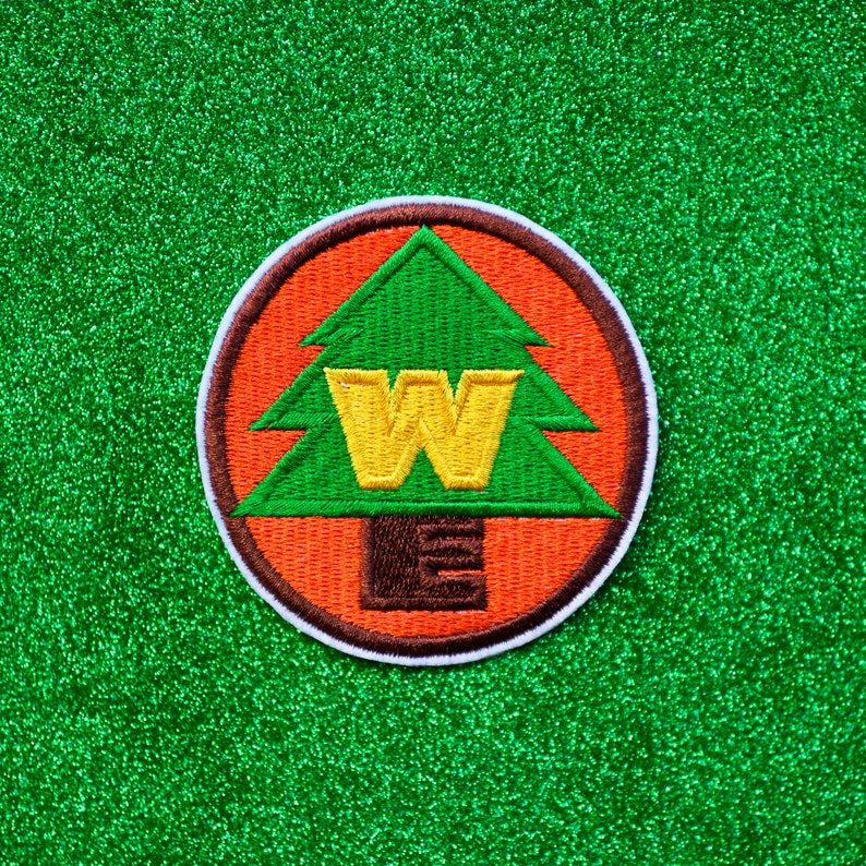 WE Badge Embroidered Iron On Patch