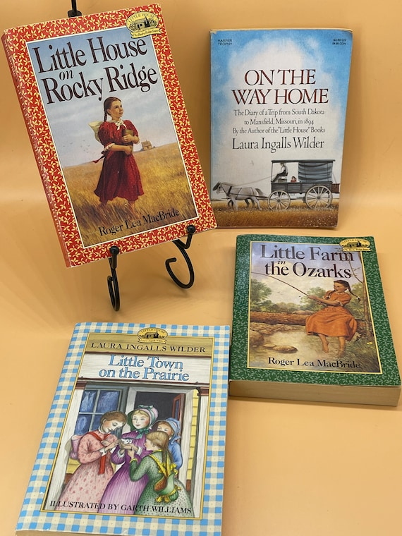 Set of 4 Little House on the Prairie themed books. Paperback Young Readers Little House Series.