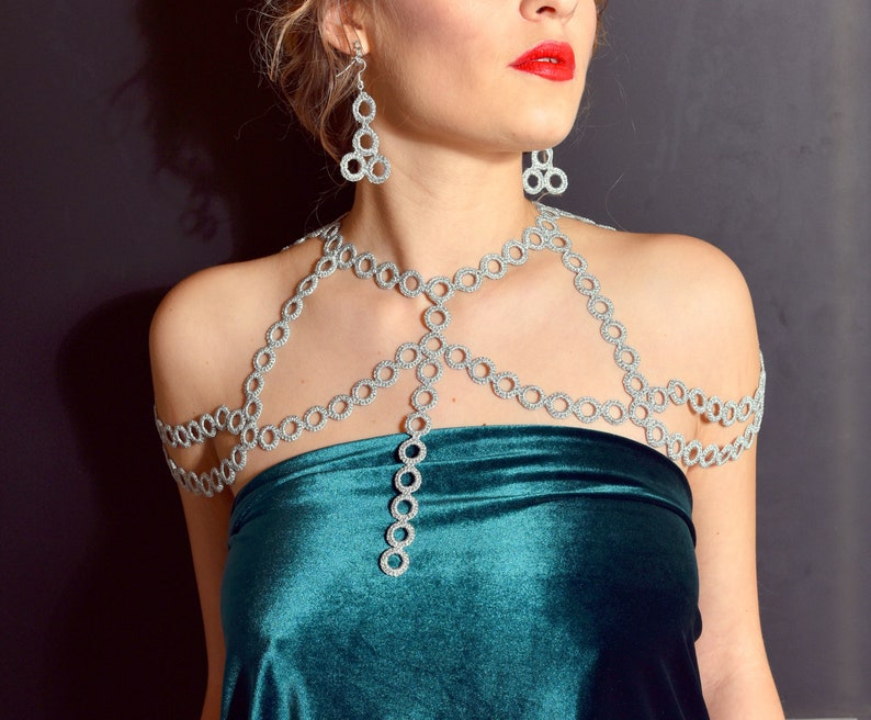 Silver color shoulder jewelry and  earrings are great festive outfit for ladies