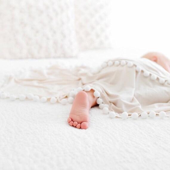 Ivory Pom Swaddle Blanket
