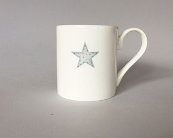Bone china mug with star.  Free P&P