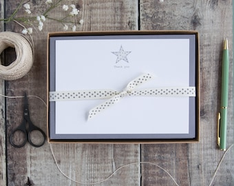 Correspondence cards with star and the words 'Thank you'