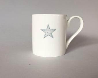Bone china mug with star.  Free P&P