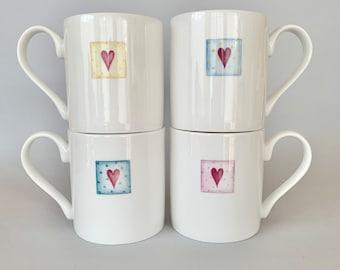 Set of 4 Bone china mugs with heart. Free P&P