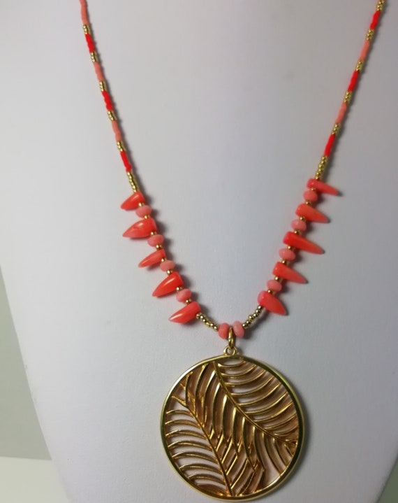 golden long necklace with a tropical golden leaf pendant,