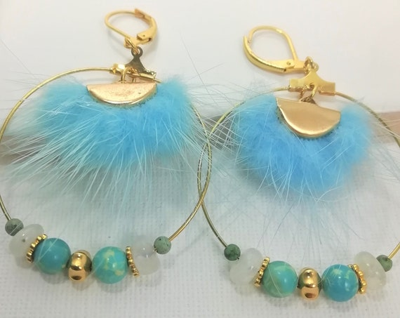 Gold plated hoop earrings with fine stones and half-moon blue fur connector