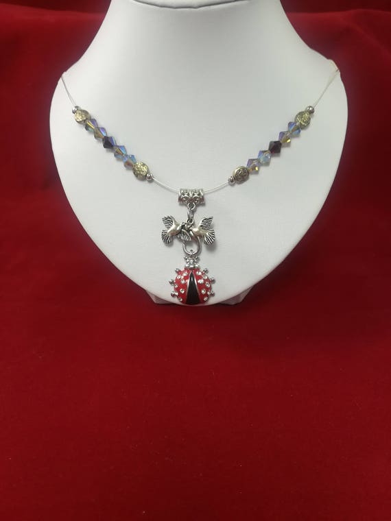 swarovski necklace with a lucky lady bird