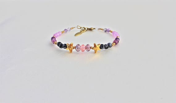 Bracelet gemstones: Obsidian, jade, kiwi, lavender jade, fluorite and swarovski