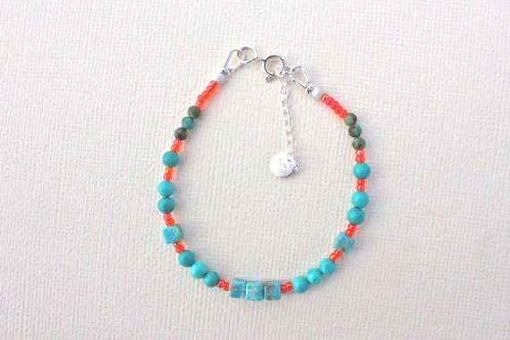 silver bracelet with precious stones : african turquoise, stabilized chinese turquoise and orange seed beads