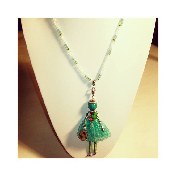 long necklace with turquoise doll, swarovski cabochons and tubular fishnet