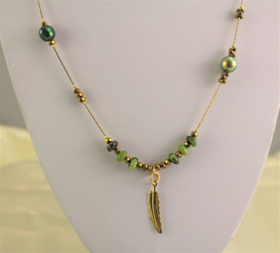 bohemian chic long necklace with gree swarovski pearls, semi-precious stone : chrysoprase, bronze seed beads and a golden plated chain