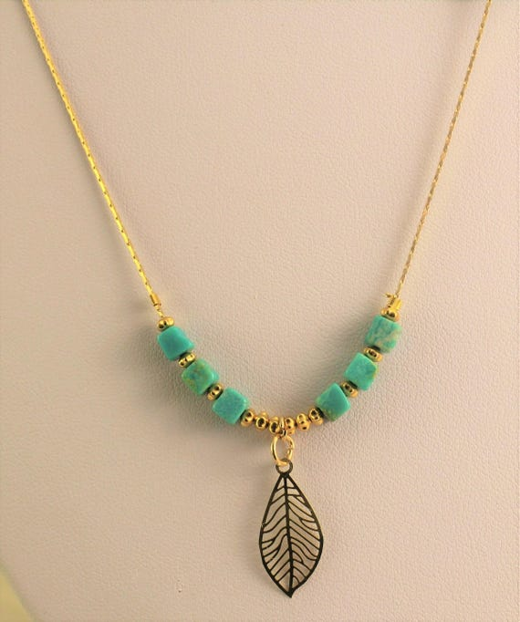 gold plated boho necklace with leaf and turquoise gemstones