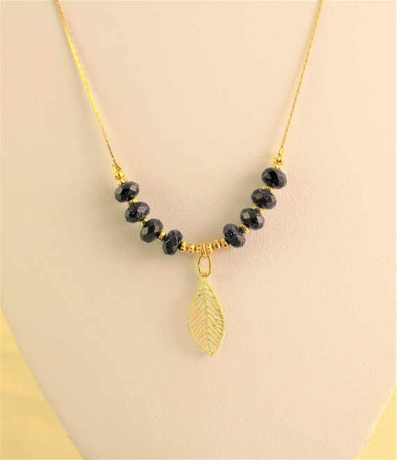 Necklace boho chic with precious stones and leaf pendant