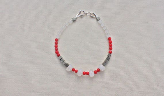 Bracelet gemstones: rainbow moonstone, red coral, pyrite and snow quartz faceted