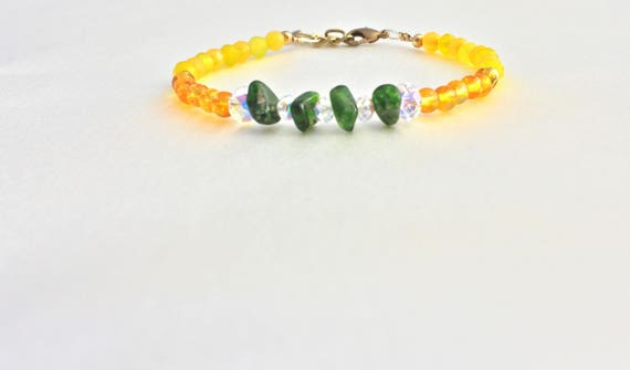 semi-precious stones : tsavorite, citrine, yellow jade  and swarovski faceted beads