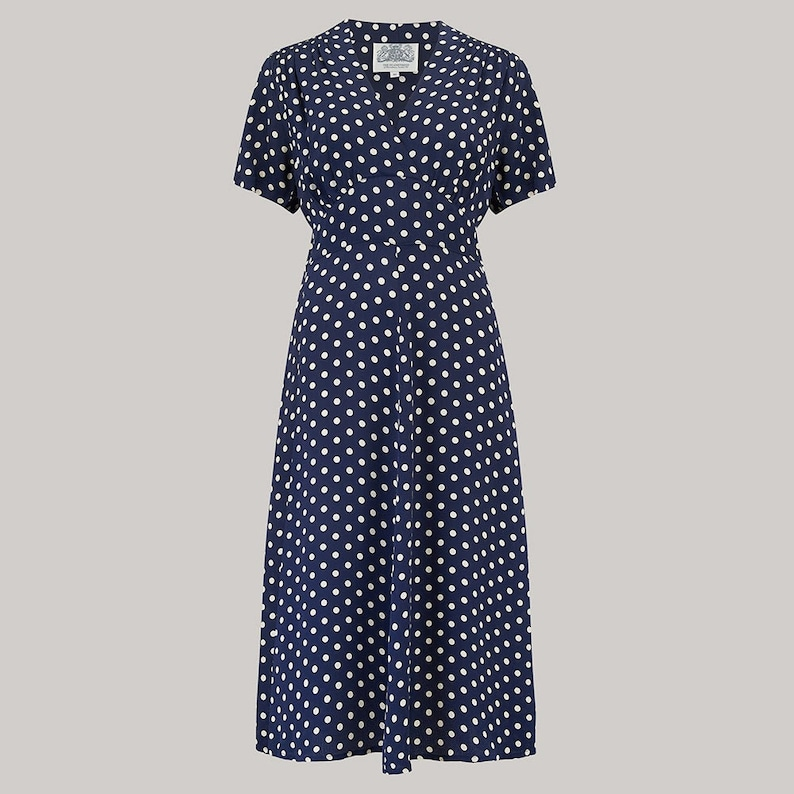 500 Vintage Style Dresses for Sale | Vintage Inspired Dresses Dolores Dress in Navy Polka Dot by The Seamstress of Bloomsbury | Authentic Vintage 1940s Style $105.87 AT vintagedancer.com